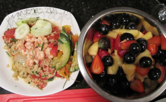 Shrimp over quinoa and fruit salad