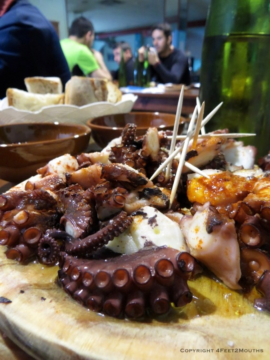 One of the best meals on the Camino, broiled octopus with chunks of bread and bowls of white wine