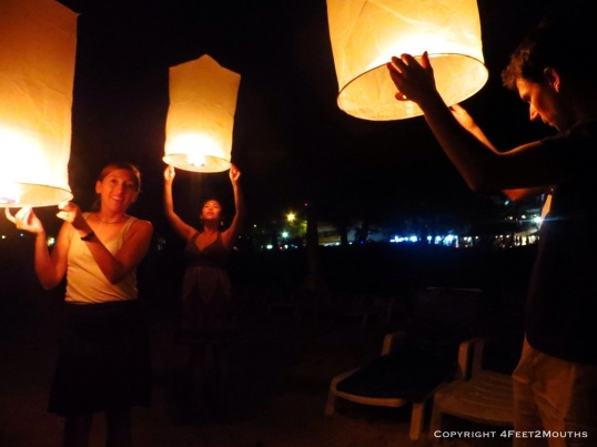 Three paper lanterns ready to take flight