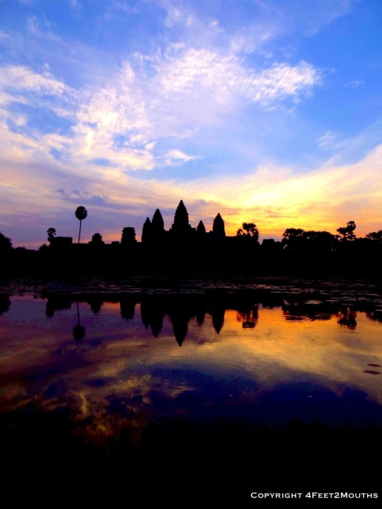 The sun rises over Angkor Wat