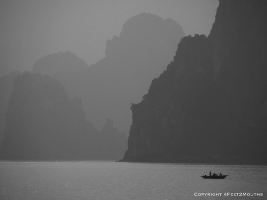 Lone fishing boat in Halong Bay