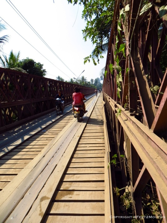 Biking with scooters on the wooden bridge