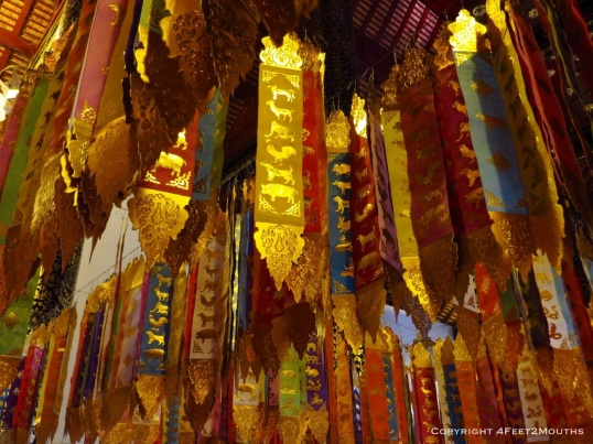 Flags inside Wat Chedi Luang