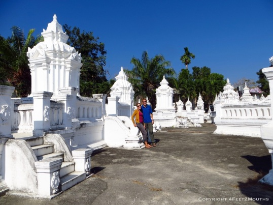White chedis at Wat Suan Dok