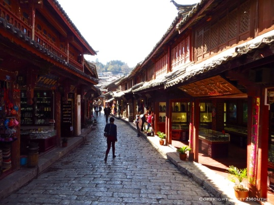 An uncrowded shopping street in old town