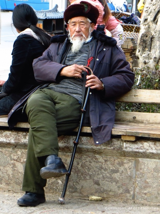 A elder checking out the touring masses in the main square