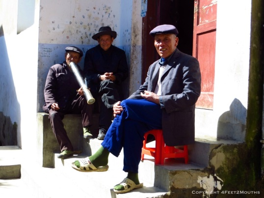 Men smoking a tobacco water pipe in Shang Village.