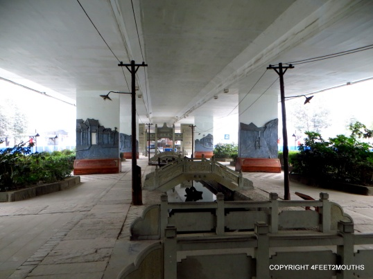 Urban design to warm up a freeway underpass, complete with mini electric poles to provide a pedestrian scale