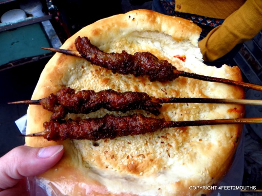Street kabob on sesame flatbread