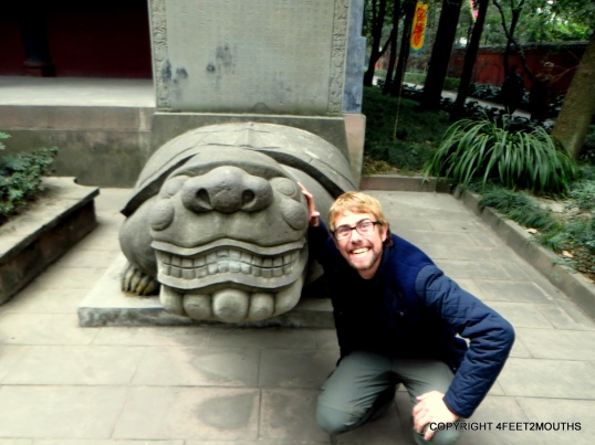Nathan and a grinning turtle at the temple