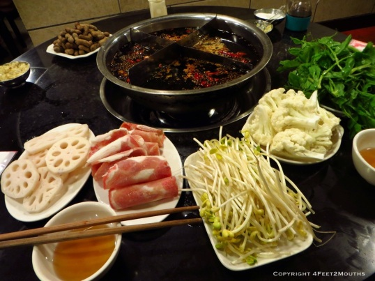 More glorious hot pot with lotus root, bean sprouts, shaved beef and cauliflower