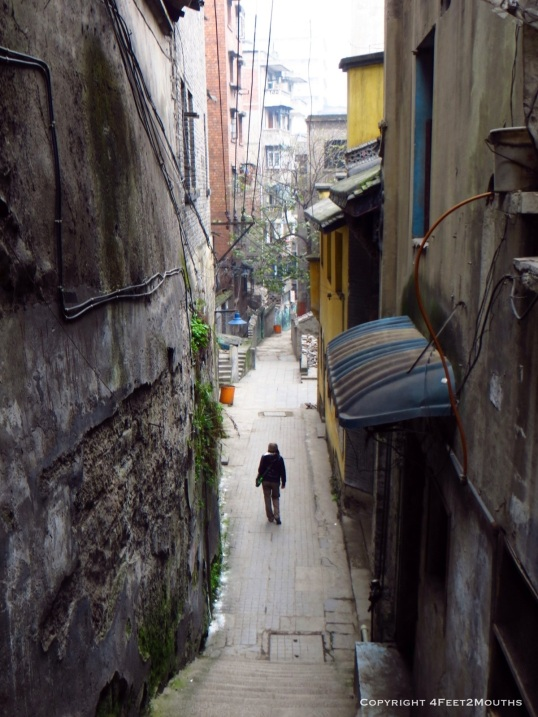 Carmen exploring a narrow alleyway