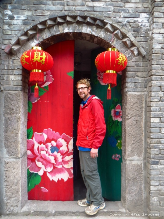 Nathan at the doorway of Yangtze River Hostel