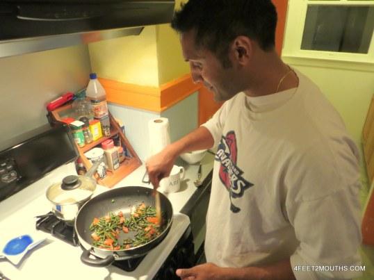 Manish slaving away at the stove